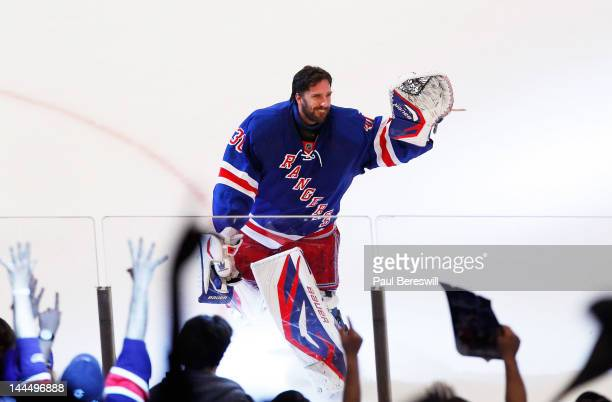 Henrik Lundqvist of the New York Rangers waves to the crowd after their 3 to 0 win over the New Jersey Devils in Game One of the Eastern Conference...