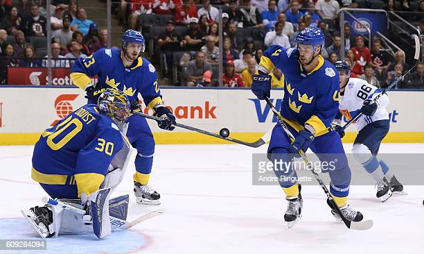 Henrik Lundqvist Oliver EkmanLarsson and Niklas Hjalmarsson of Team Sweden follow a loose puck during the World Cup of Hockey 2016 at Air Canada...