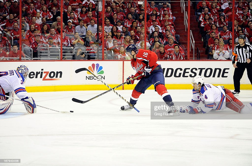 <a gi-track='captionPersonalityLinkClicked' href=/galleries/search?phrase=Henrik+Lundqvist&family=editorial&specificpeople=217958 ng-click='$event.stopPropagation()'>Henrik Lundqvist</a> #30 the New York Rangers makes a save in the third period against <a gi-track='captionPersonalityLinkClicked' href=/galleries/search?phrase=Eric+Fehr&family=editorial&specificpeople=566939 ng-click='$event.stopPropagation()'>Eric Fehr</a> #16 of the Washington Capitals in Game One of the Eastern Conference Quarterfinals during the 2013 NHL Stanley Cup Playoffs at Verizon Center on May 2, 2013 in Washington, DC. <a gi-track='captionPersonalityLinkClicked' href=/galleries/search?phrase=Michael+Del+Zotto&family=editorial&specificpeople=4044191 ng-click='$event.stopPropagation()'>Michael Del Zotto</a> was given a penalty on the play.