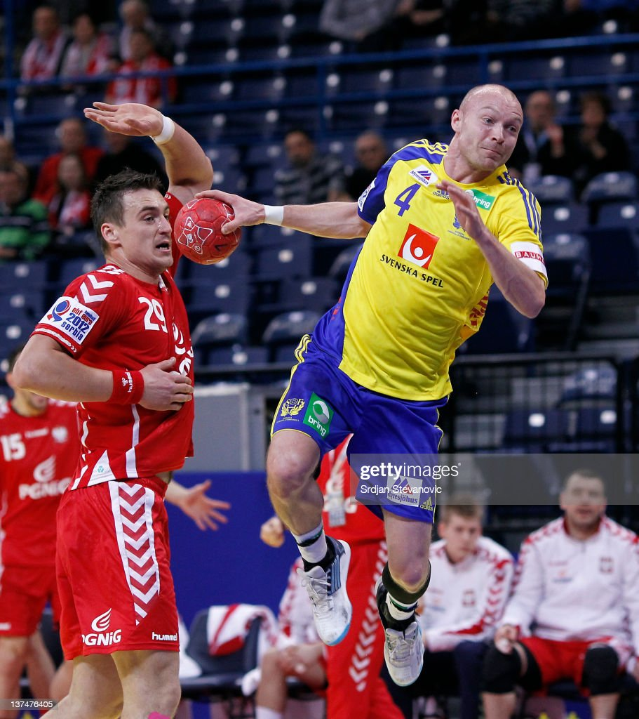 Henrik Lundstrom (R) of Sweden scores a goal past Zbigniew Kwiatkowski (L) of Poland, during the Men's European Handball Championship 2012 main group 1 match between Poland and Sweden at Belgrade Arena Hall on January 21, 2011 in Belgrade, Serbia.
