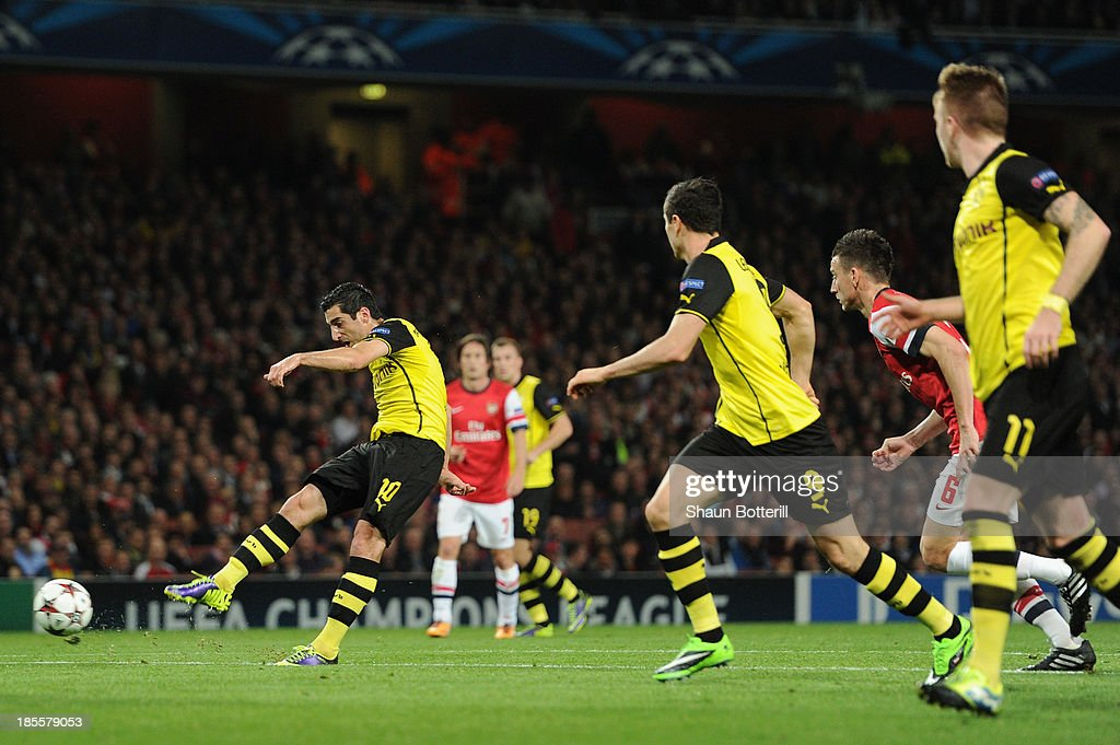Henrik Mkhitaryan of Borussia Dortmund scores the first goal during the UEFA Champions League Group F match between Arsenal and Borussia Dortmund at Emirates Stadium on October 22, 2013 in London, England.