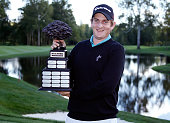 Henrik Norlander of Sweden holds the championship trophy after winning the Webcom Tour Hotel Fitness Championship with a tournament total of 19 under...