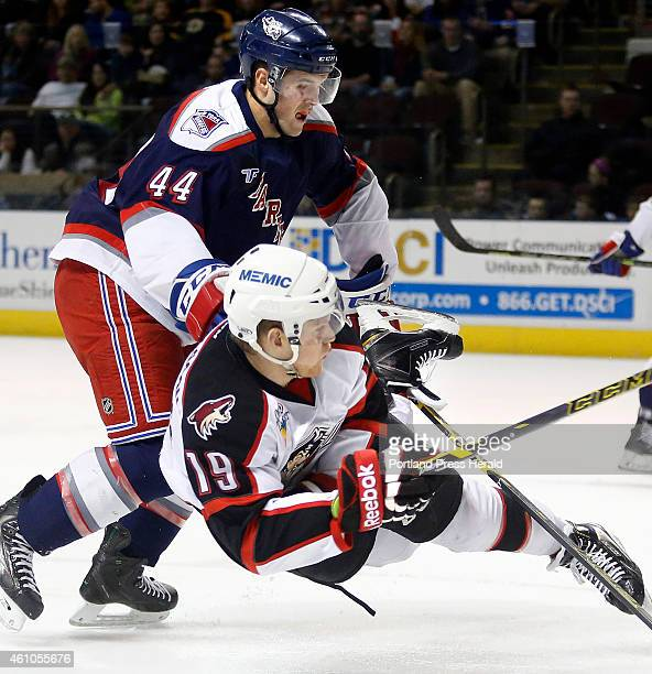 Henrik Samuelsson of Portland is knocked to the ice by Hartford's Steve Spinell after he fired off a shot during the first period Portland Pirates vs...
