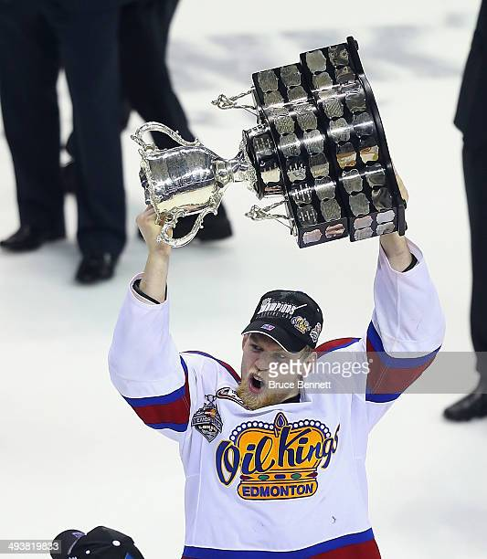 Henrik Samuelsson of the Edmonton Oil Kings skates with the Memorial Cup trophy following a 63 victory over the Guelph Storm in the 2014 Memorial Cup...