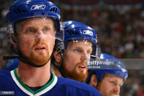 Henrik Sedin and Daniel Sedin of the Vancouver Canucks look on against the Anaheim Ducks in Game Three of the 2007 Western Conference Semifinals at...