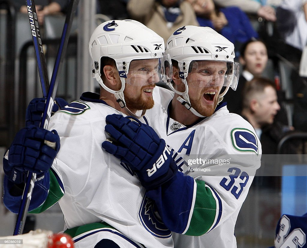 <a gi-track='captionPersonalityLinkClicked' href=/galleries/search?phrase=Henrik+Sedin&family=editorial&specificpeople=202574 ng-click='$event.stopPropagation()'>Henrik Sedin</a> #33 and <a gi-track='captionPersonalityLinkClicked' href=/galleries/search?phrase=Daniel+Sedin&family=editorial&specificpeople=202492 ng-click='$event.stopPropagation()'>Daniel Sedin</a> #22of the Vancouver Canucks celebrate goal during game action against the Toronto Maple Leafs January 30, 2010 at the Air Canada Centre in Toronto, Ontario, Canada.
