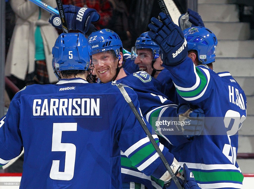 <a gi-track='captionPersonalityLinkClicked' href=/galleries/search?phrase=Henrik+Sedin&family=editorial&specificpeople=202574 ng-click='$event.stopPropagation()'>Henrik Sedin</a> #33 and <a gi-track='captionPersonalityLinkClicked' href=/galleries/search?phrase=Jason+Garrison&family=editorial&specificpeople=2143635 ng-click='$event.stopPropagation()'>Jason Garrison</a> #5 congratulate <a gi-track='captionPersonalityLinkClicked' href=/galleries/search?phrase=Daniel+Sedin&family=editorial&specificpeople=202492 ng-click='$event.stopPropagation()'>Daniel Sedin</a> #22 of the Vancouver Canucks after Sedin scored the winning goal against the Colorado Avalanche during an NHL game at Rogers Arena March 28, 2013 in Vancouver, British Columbia, Canada. Vancouver won 4-1.