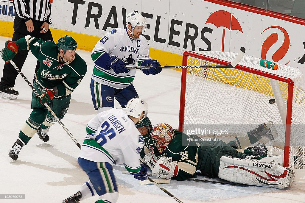 <a gi-track='captionPersonalityLinkClicked' href=/galleries/search?phrase=Henrik+Sedin&family=editorial&specificpeople=202574 ng-click='$event.stopPropagation()'>Henrik Sedin</a> #33 and the Vancouver Canucks narrowly miss a goal against (L-R) <a gi-track='captionPersonalityLinkClicked' href=/galleries/search?phrase=Eric+Nystrom&family=editorial&specificpeople=2209813 ng-click='$event.stopPropagation()'>Eric Nystrom</a> #23, <a gi-track='captionPersonalityLinkClicked' href=/galleries/search?phrase=Greg+Zanon&family=editorial&specificpeople=567162 ng-click='$event.stopPropagation()'>Greg Zanon</a> #5, and goalie <a gi-track='captionPersonalityLinkClicked' href=/galleries/search?phrase=Anton+Khudobin&family=editorial&specificpeople=722106 ng-click='$event.stopPropagation()'>Anton Khudobin</a> #35 of the Minnesota Wild during the game at Xcel Energy Center on January 16, 2011 in Saint Paul, Minnesota.