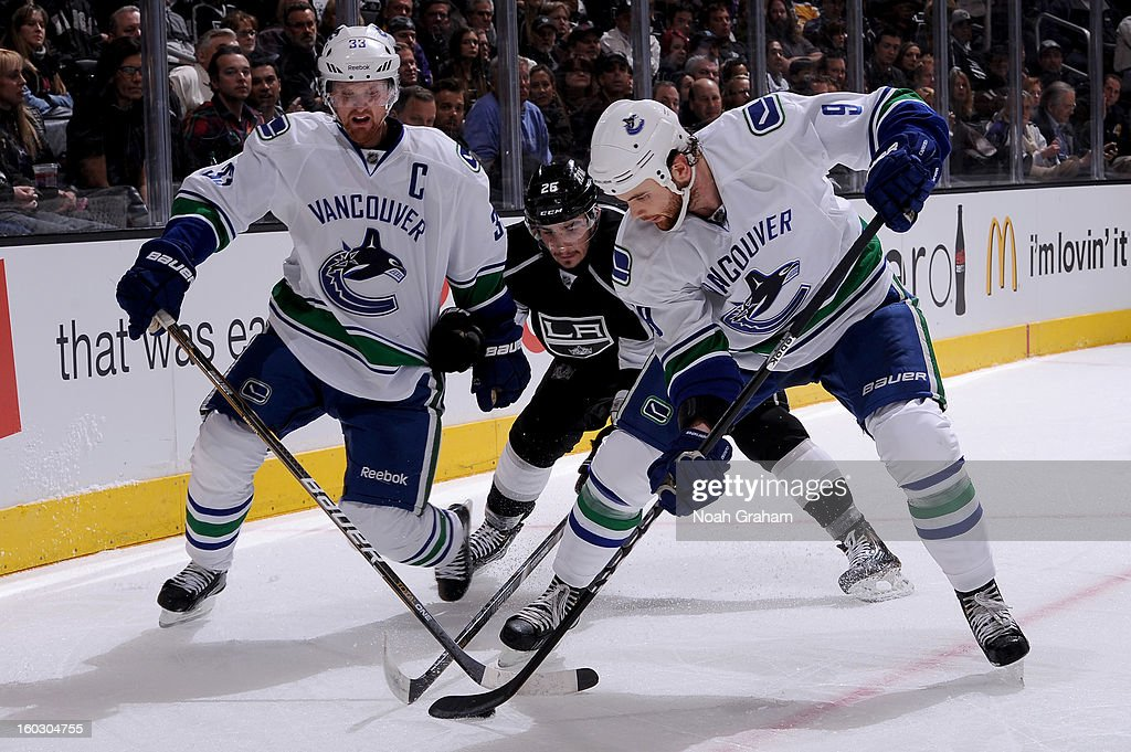 <a gi-track='captionPersonalityLinkClicked' href=/galleries/search?phrase=Henrik+Sedin&family=editorial&specificpeople=202574 ng-click='$event.stopPropagation()'>Henrik Sedin</a> #33 and <a gi-track='captionPersonalityLinkClicked' href=/galleries/search?phrase=Zack+Kassian&family=editorial&specificpeople=4604939 ng-click='$event.stopPropagation()'>Zack Kassian</a> #9 of the Vancouver Canucks skates with the puck against <a gi-track='captionPersonalityLinkClicked' href=/galleries/search?phrase=Slava+Voynov&family=editorial&specificpeople=8315719 ng-click='$event.stopPropagation()'>Slava Voynov</a> #26 of the Los Angeles Kings at Staples Center on January 28, 2013 in Los Angeles, California.
