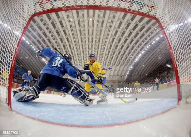 Henrik Sedin of Sweden scores past Goalkeeper Vitaliy Yeremeyev of Kazakhstan during the men's ice hockey Preliminary Round Group B match between...