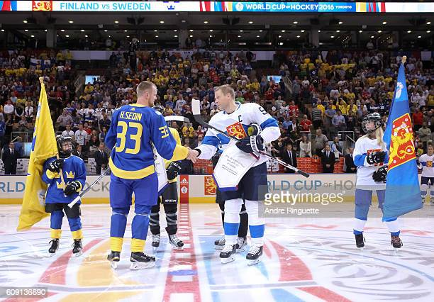 Henrik Sedin of Team Sweden shakes hands with Mikko Koivu of Team Finland during the World Cup of Hockey 2016 at Air Canada Centre on September 20...