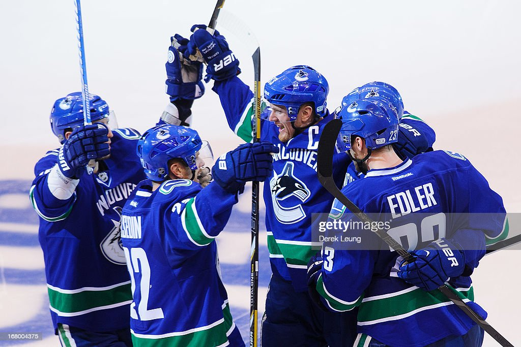 <a gi-track='captionPersonalityLinkClicked' href=/galleries/search?phrase=Henrik+Sedin&family=editorial&specificpeople=202574 ng-click='$event.stopPropagation()'>Henrik Sedin</a> #33 of the Vancouver Canucks celebrates a third period goal by Ryan Kesler #17 (not pictured) against the San Jose Sharks in Game Two of the Western Conference Quarterfinals during the 2013 NHL Stanley Cup Playoffs at Rogers Arena on May 3, 2013 in Vancouver, British Columbia, Canada.