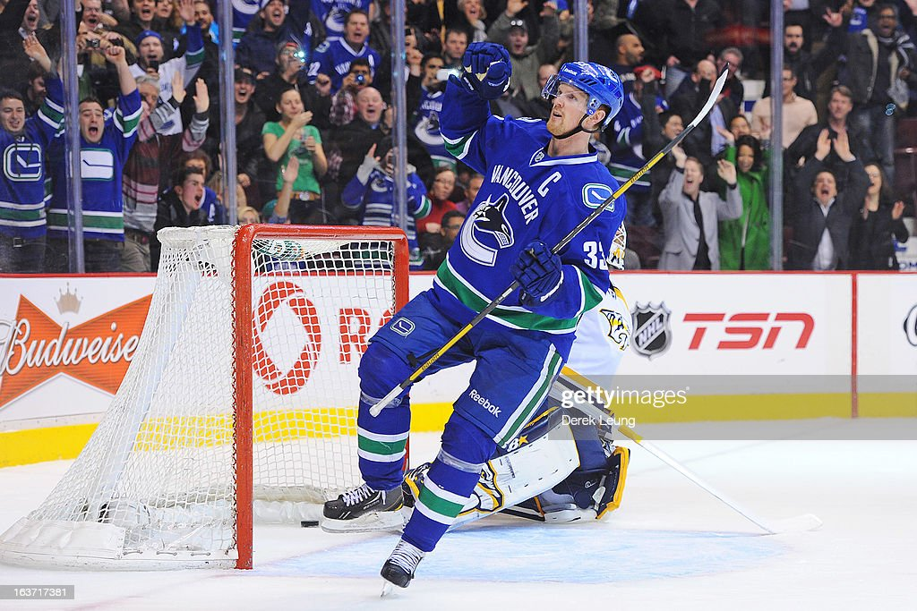 <a gi-track='captionPersonalityLinkClicked' href=/galleries/search?phrase=Henrik+Sedin&family=editorial&specificpeople=202574 ng-click='$event.stopPropagation()'>Henrik Sedin</a> #33 of the Vancouver Canucks celebrates after scoring on Chris Mason #30 of the Nashville Predators during an NHL game at Rogers Arena on March 14, 2013 in Vancouver, British Columbia, Canada. The Vancouver Canucks won 7-4.