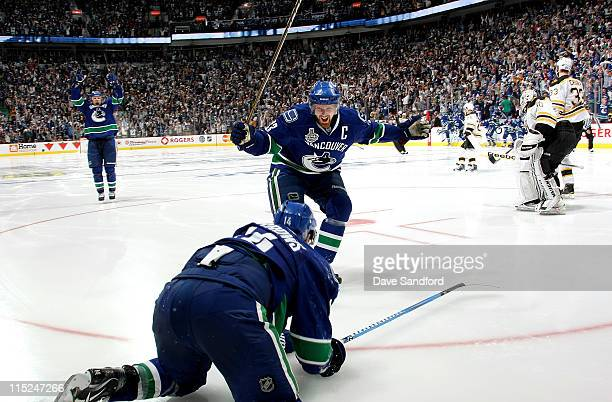 Henrik Sedin of the Vancouver Canucks celebrates the overtime goal by teammate Alex Burrows to win game two of the 2011 NHL Stanley Cup Finals...