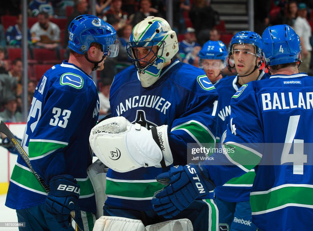 <a gi-track='captionPersonalityLinkClicked' href=/galleries/search?phrase=Henrik+Sedin&family=editorial&specificpeople=202574 ng-click='$event.stopPropagation()'>Henrik Sedin</a> #33 of the Vancouver Canucks congratulates teammate <a gi-track='captionPersonalityLinkClicked' href=/galleries/search?phrase=Roberto+Luongo&family=editorial&specificpeople=202638 ng-click='$event.stopPropagation()'>Roberto Luongo</a> #1 for his play against the Anaheim Ducks at Rogers Arena April 25, 2013 in Vancouver, British Columbia, Canada. Anaheim won 3-1.