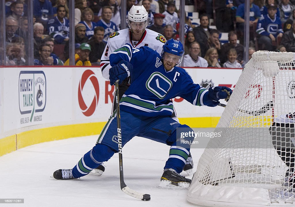 <a gi-track='captionPersonalityLinkClicked' href=/galleries/search?phrase=Henrik+Sedin&family=editorial&specificpeople=202574 ng-click='$event.stopPropagation()'>Henrik Sedin</a> #33 of the Vancouver Canucks is taken down by <a gi-track='captionPersonalityLinkClicked' href=/galleries/search?phrase=Duncan+Keith&family=editorial&specificpeople=4194433 ng-click='$event.stopPropagation()'>Duncan Keith</a> #2 of the Chicago Blackhawks behind the net during the third period in NHL action on February 01, 2013 at Rogers Arena in Vancouver, British Columbia, Canada.