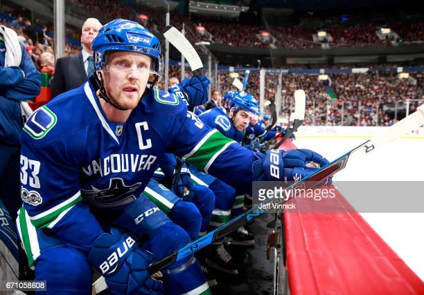 Henrik Sedin of the Vancouver Canucks looks on from the bench during their NHL game against the Los Angeles Kings at Rogers Arena March 31 2017 in...