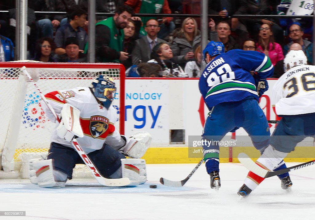 Henrik Sedin #33 of the Vancouver Canucks scores on Roberto Luongo #1 of the Florida Panthers, marking 1000 career points, during their NHL game at Rogers Arena January 20, 2017 in Vancouver, British Columbia, Canada.