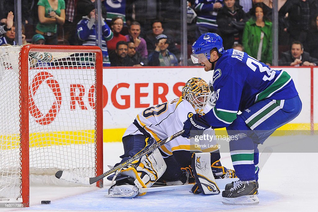 <a gi-track='captionPersonalityLinkClicked' href=/galleries/search?phrase=Henrik+Sedin&family=editorial&specificpeople=202574 ng-click='$event.stopPropagation()'>Henrik Sedin</a> #33 of the Vancouver Canucks shoots the puck past <a gi-track='captionPersonalityLinkClicked' href=/galleries/search?phrase=Chris+Mason+-+Ice+Hockey+Player&family=editorial&specificpeople=171262 ng-click='$event.stopPropagation()'>Chris Mason</a> #30 of the Nashville Predators on a penalty shot during an NHL game at Rogers Arena on March 14, 2013 in Vancouver, British Columbia, Canada. The Vancouver Canucks won 7-4.