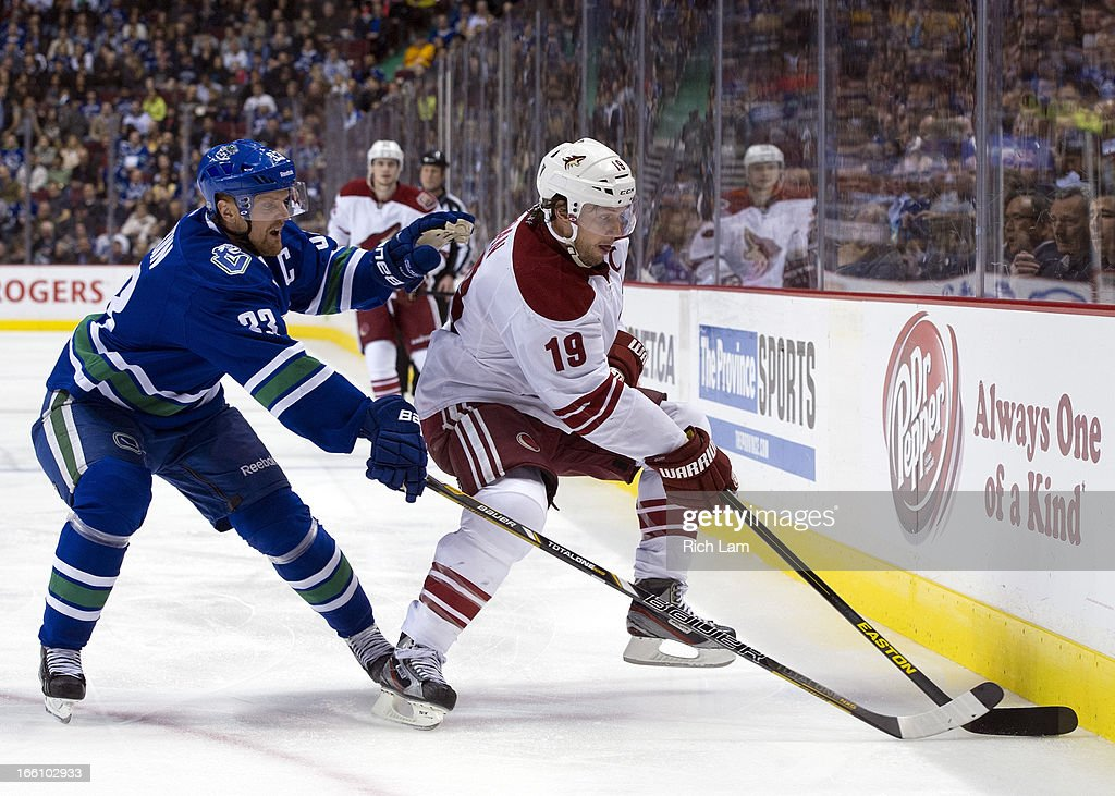 Henrik Sedin #33 of the Vancouver Canucks tries to check Shane Doan #19 of the Phoenix Coyotes off the puck during the second period in NHL action on April 08, 2013 at Rogers Arena in Vancouver, British Columbia, Canada.