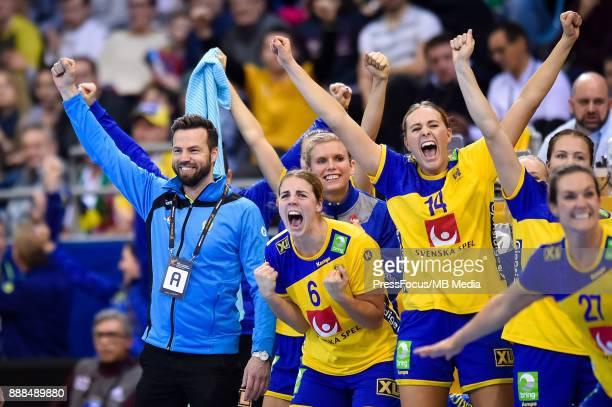 Henrik Signell head coach of Sweden Carin Stroemberg Johanna Westberg and Sabina Jacobsen of Sweden celebrates scoring a goal during IHF Women's...