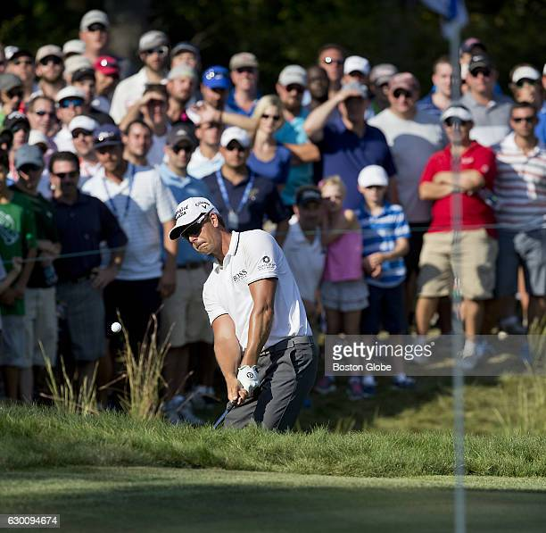 Henrik Stenson chips from the bunker on the 11th hole during the finalround action of the Deutsche Bank Championship at TPC Boston in Norton MA on...