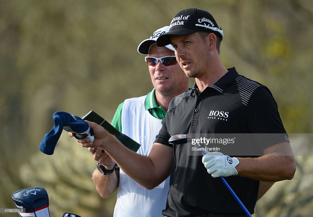 <a gi-track='captionPersonalityLinkClicked' href=/galleries/search?phrase=Henrik+Stenson&family=editorial&specificpeople=211537 ng-click='$event.stopPropagation()'>Henrik Stenson</a> of Sweden and caddie Gareth Lord ponder during the first round of the World Golf Championships - Accenture Match Play Championship at The Golf Club at Dove Mountain on February 19, 2014 in Marana, Arizona.
