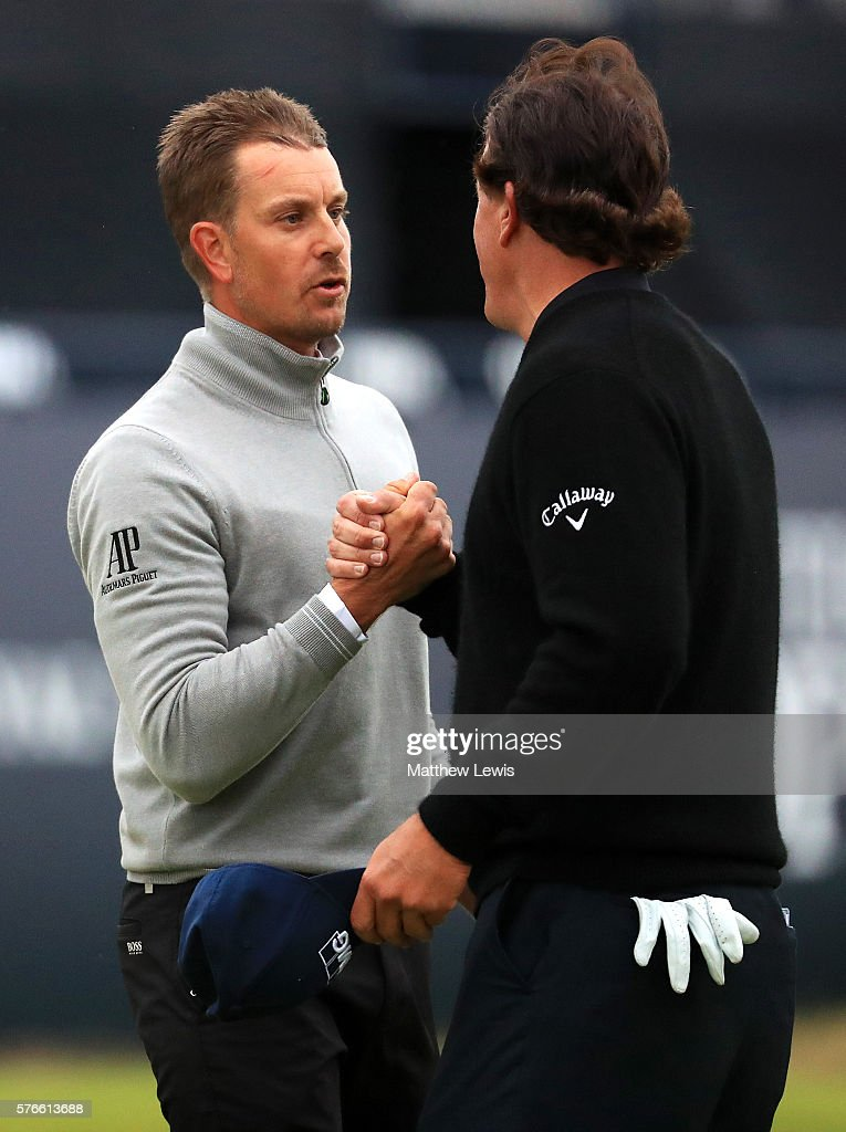 Henrik Stenson of Sweden and Phil Mickelson of the United States shake hands after their round the 18th green during the third round on day three of the 145th Open Championship at Royal Troon on July 16, 2016 in Troon, Scotland.
