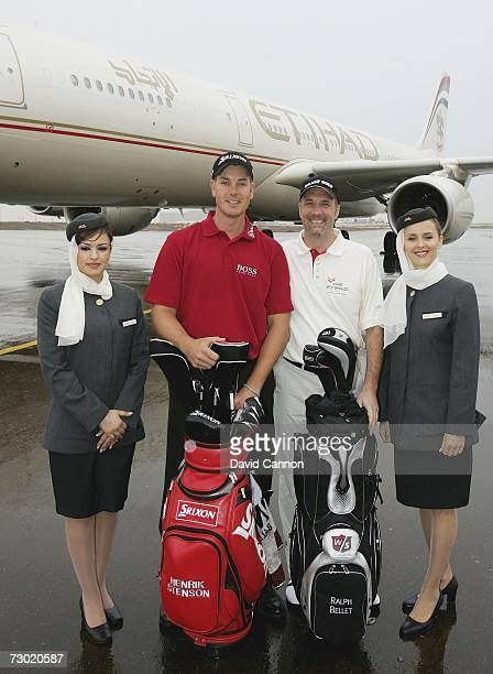 Henrik Stenson of Sweden and Ralph Bellet of Germany pose infront of a Eitihad Airways Airbus A340 parked on the runway at the Abu Dhabi...
