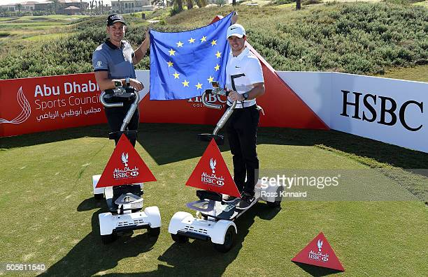 Henrik Stenson of Sweden and Rory McIlroy of Northern Ireland pictured riding a 'Golfboard' during a photocall at Saadiyat Beach Golf Club prior to...