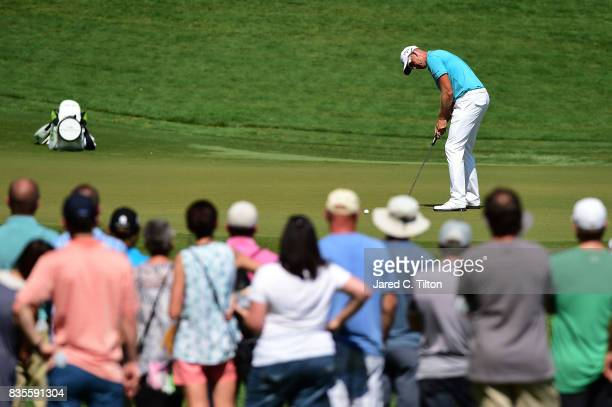 Henrik Stenson of Sweden attempts a putt on the eighth green during the third round of the Wyndham Championship at Sedgefield Country Club on August...