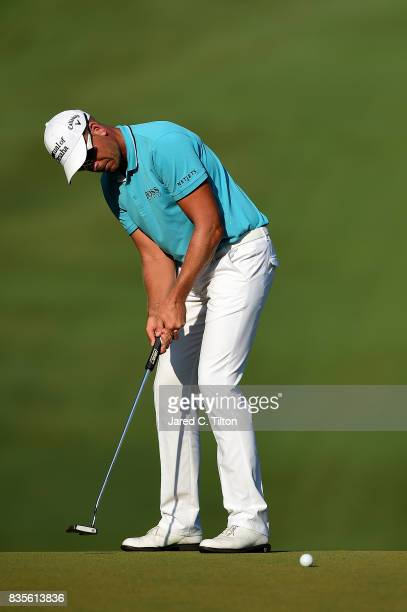 Henrik Stenson of Sweden attempts his birdie putt on the 18th green during the third round of the Wyndham Championship at Sedgefield Country Club on...