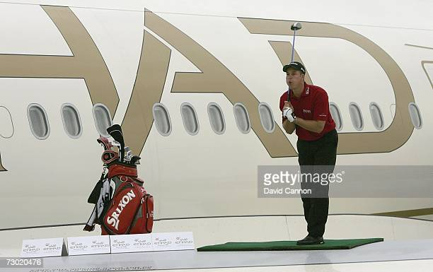Henrik Stenson of Sweden blows hard after hitting his record drive of 721 yards during the 'Etihad Airways Swing on the Wing Challenge' while...