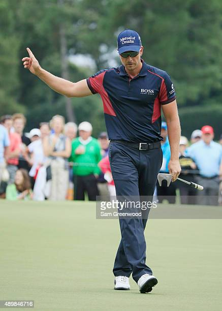 Henrik Stenson of Sweden celebrates an eagle putt on the ninth hole during the first round of the TOUR Championship By CocaCola at East Lake Golf...