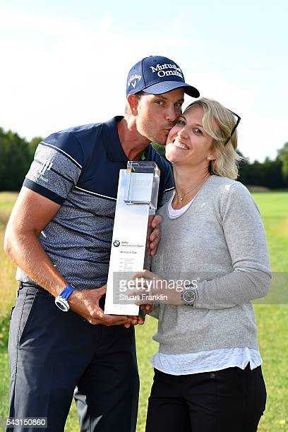 Henrik Stenson of Sweden celebrates his 3 shot victory with wife Emma and the trophy after the final round of the BMW International Open at Gut...
