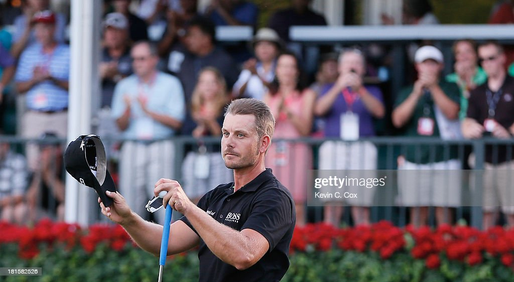 <a gi-track='captionPersonalityLinkClicked' href=/galleries/search?phrase=Henrik+Stenson&family=editorial&specificpeople=211537 ng-click='$event.stopPropagation()'>Henrik Stenson</a> of Sweden celebrates on the 18th green after winning the TOUR Championship by Coca-Cola and the FedExCup Playoffs at East Lake Golf Club on September 22, 2013 in Atlanta, Georgia.