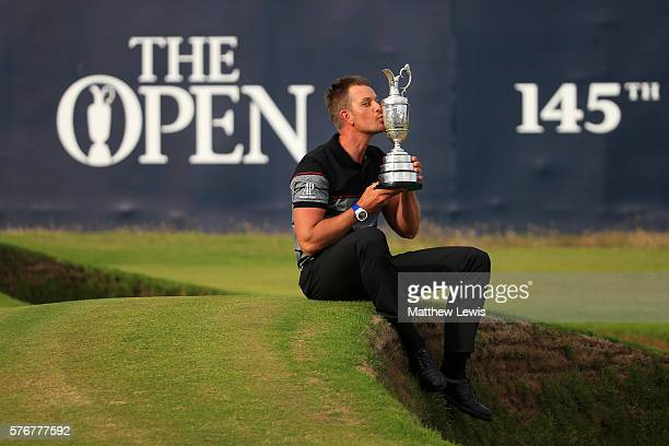 Henrik Stenson of Sweden celebrates victory as he kisses the Claret Jug on the the 18th green after the final round on day four of the 145th Open...