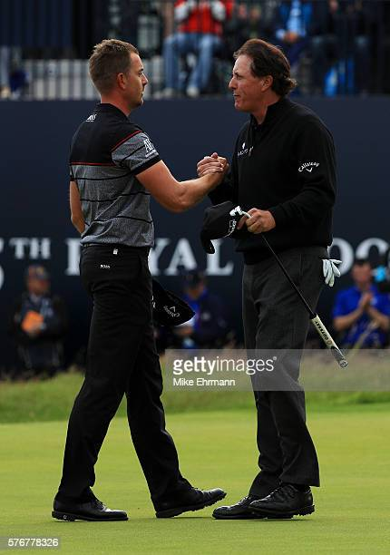 Henrik Stenson of Sweden celebrates victory on the 18th green with Phil Mickelson of the United States after the final round on day four of the 145th...