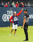 Henrik Stenson of Sweden celebrates victory with caddie Garath Lord after the winning putt during the final round on day four of the 145th Open...