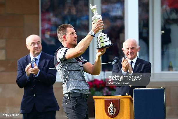 Henrik Stenson of Sweden celebrates victory with the Claret Jug in front of the presentation party on the the 18th green after the final round on day...