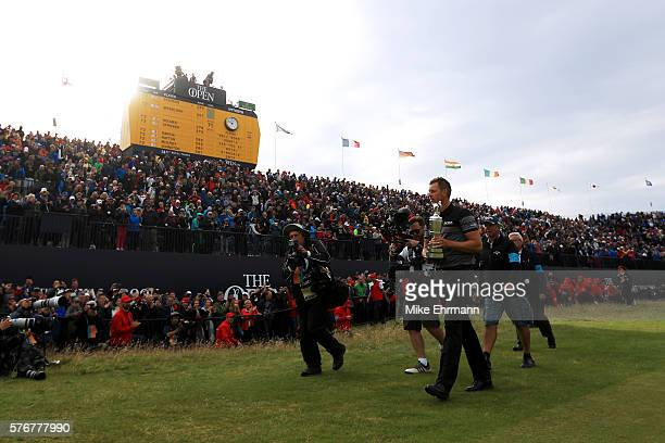 Henrik Stenson of Sweden celebrates victory with the Claret Jug on the the 18th green after the final round on day four of the 145th Open...