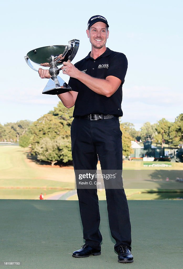 <a gi-track='captionPersonalityLinkClicked' href=/galleries/search?phrase=Henrik+Stenson&family=editorial&specificpeople=211537 ng-click='$event.stopPropagation()'>Henrik Stenson</a> of Sweden celebrates with the FedExCup on the 18th green after winning the TOUR Championship by Coca-Cola and the FedExCup Playoffs at East Lake Golf Club on September 22, 2013 in Atlanta, Georgia.