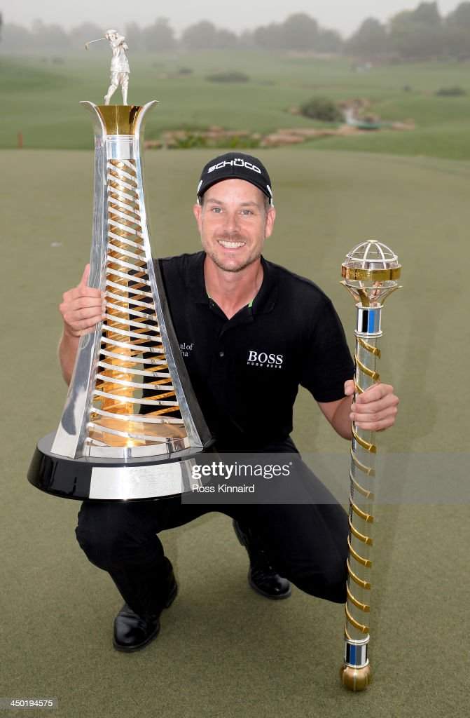 <a gi-track='captionPersonalityLinkClicked' href=/galleries/search?phrase=Henrik+Stenson&family=editorial&specificpeople=211537 ng-click='$event.stopPropagation()'>Henrik Stenson</a> of Sweden celebrates with the Race to Dubai and the DP World Championship trophies after the final round of the 2013 DP World Championship on the Earth Course at the Jumeirah Golf Estates on November 17, 2013 in Dubai, United Arab Emirates.