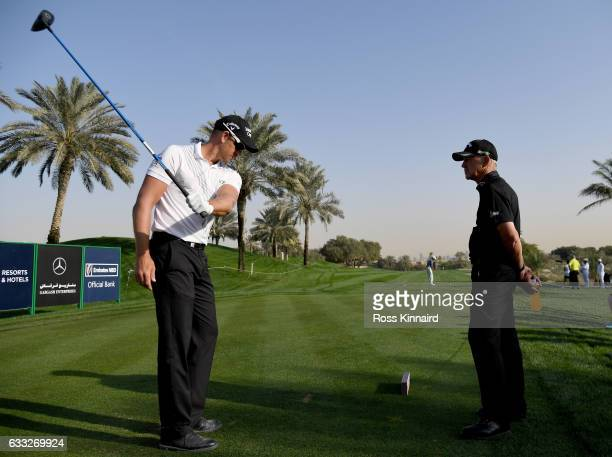 Henrik Stenson of Sweden chatting with his coach Pete Cowen on the 14th tee during the proam event prior to the Omega Dubai Desert Classic at...