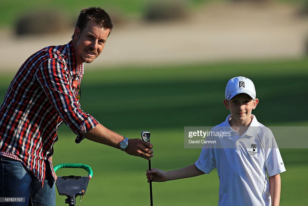 <a gi-track='captionPersonalityLinkClicked' href=/galleries/search?phrase=Henrik+Stenson&family=editorial&specificpeople=211537 ng-click='$event.stopPropagation()'>Henrik Stenson</a> of Sweden choosing the club on the 16th hole for the youngest player eight year old Alex Turlik during the pro-am as a preview for the 2012 Omega Dubai Ladies Masters on the Majilis Course at the Emirates Golf Club on December 4, 2012 in Dubai, United Arab Emirates.