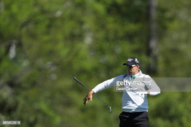 Henrik Stenson of Sweden drops his club after playing his second shot on the fifth hole hitting during the second round of the 2017 Masters...