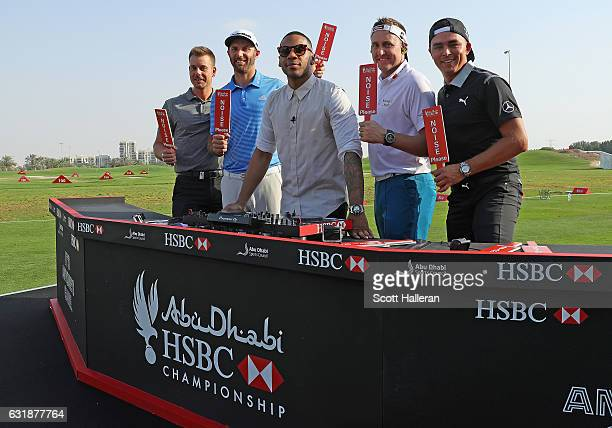 Henrik Stenson of Sweden Dustin Johnson of the USA DJ Reggie Yates Ian Poulter of England and Rickie Fowler of the USA during a photocall on the...