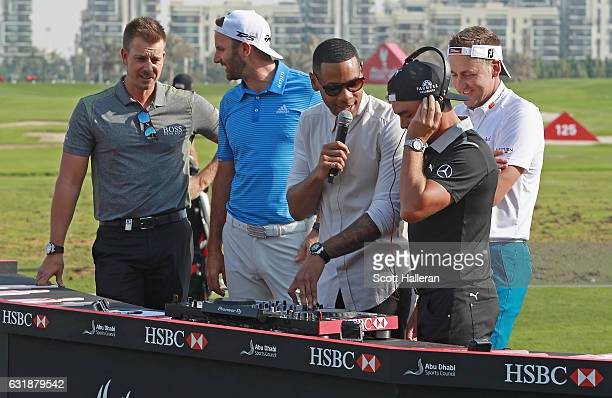 Henrik Stenson of Sweden Dustin Johnson of the USA DJ Reggie Yates Rickie Fowler of the USA and Ian Poulter of England during a photocall on the...