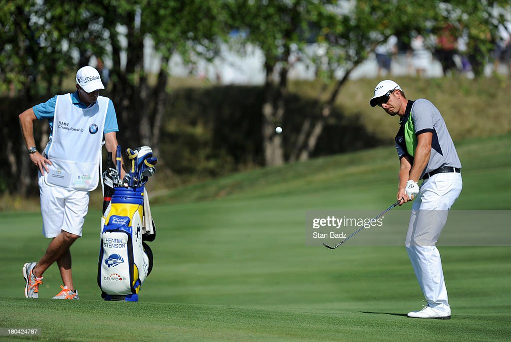 Henrik Stenson of Sweden hits a chip shot on the 12th hole during the first round of the BMW Championship at Conway Farms Golf Club on September 12, 2013 in Lake Forest, Illinois.