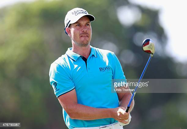 Henrik Stenson of Sweden hits a shot during a practice round prior to the start of the World Golf ChampionshipsCadillac Championship at Trump...